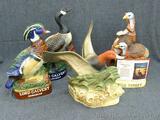 Lord Calvert, Ducks Unlimited, Wild Turkey decanters - all depict birds. Lord Calvert decanters are