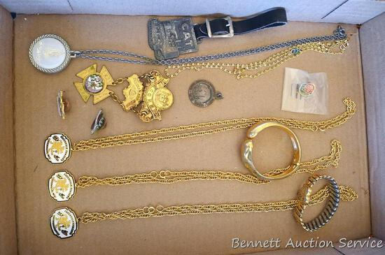 Caterpillar watch fob, Lugerville Chasers necklaces, Wisconsin Rebekah Assembly brooch, more.
