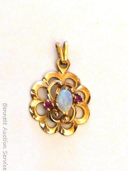 Nice pendant with an opal-like stone, clasp that attaches pendant to chain is marked 14K. Weighs 2.5