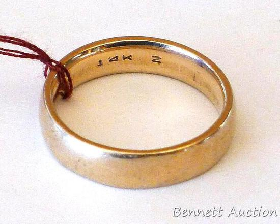 14K gold band is size 10. Ring weighs 7.5 grams and has nice rounded edges for comfort and easy