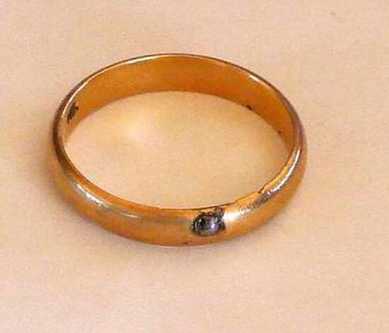 14K gold wedding band is size 10-3/4. Ring weighs 4.0 grams and has a weld BB stuck to it.