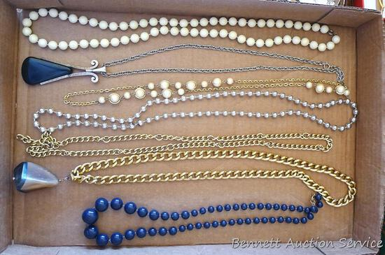 "Seven beaded and chain necklaces, longest is 16-1/2"" over pendant."