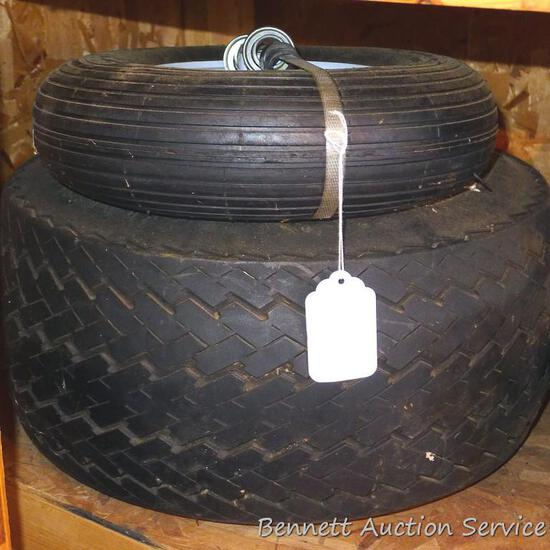 New front tire for wheelbarrow with heavy duty ball bearings; spare snowmobile trailer tire.
