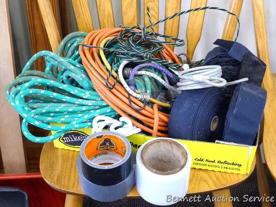 "Extension cord; duck tape; plastic marking tape; partial rolls of 2"" velcro; partial roll of Gorilla"