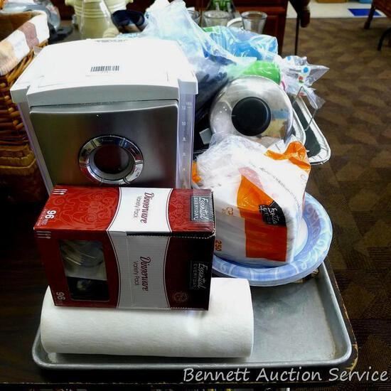 Kitchen supplies including Gevalia 12 cup coffee maker, plastic ware, napkins, paper plates, cups,