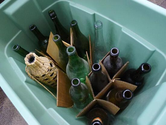 "Large tote with green and brown bottles, largest is 13"" tall."