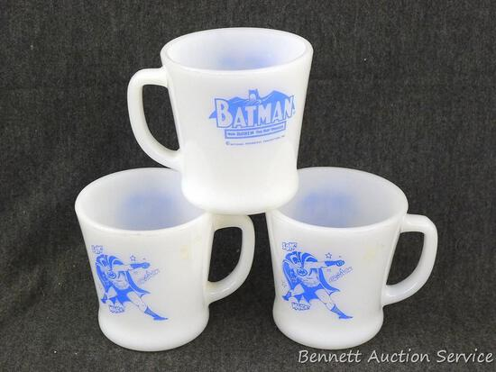 "Three matching Anchor Hocking Fire-King Batman mugs are about 3-1/2"" tall."