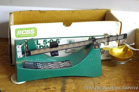 """RCBS 5-0-5 reloading scale with ounce to grain conversion chart is 12"""" x 2"""" x 3-1/2"""" tall."""