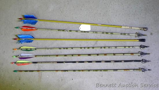 "Six Easton Camo Hunter XX75 fiberglass arrows with broad heads are 32"" long;"