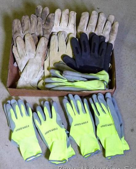 Lots of leather and rubber gloves adult size.