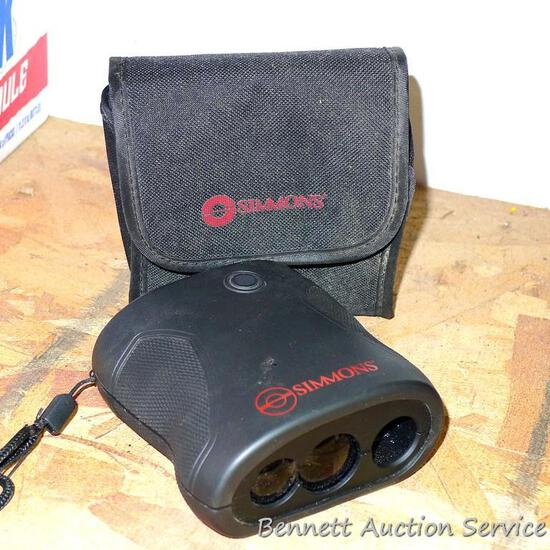 """Simmons range finder binoculars with carry case is 4"""" x 4""""."""