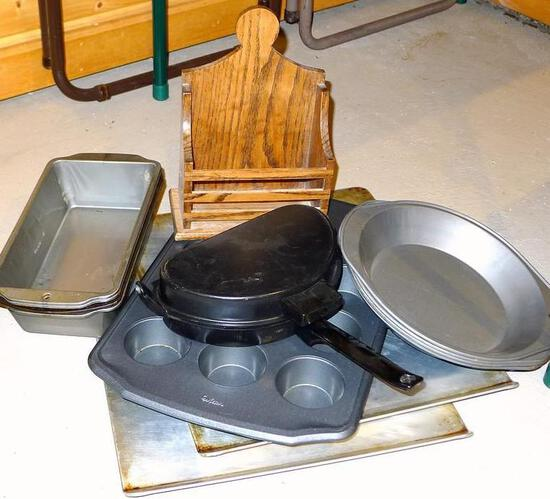 Two Air-Bake cookie sheets, egg poacher, bread and cake pans.