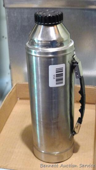 "Hot-Cold stainless steel Champ thermos is 12-1/2"" tall. A couple of minor dents noted on sides,"