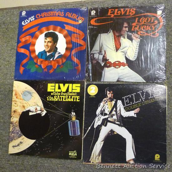 Several Elvis Presley record albums include Double Dynamite, Aloha From Hawaii via Satellite, I Got