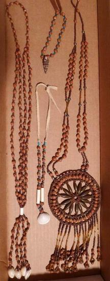 "Native American jewelry made from seeds, shells, beads and leather. Longest is 21""."