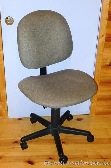 Comfortable rolling office chair in good shape.