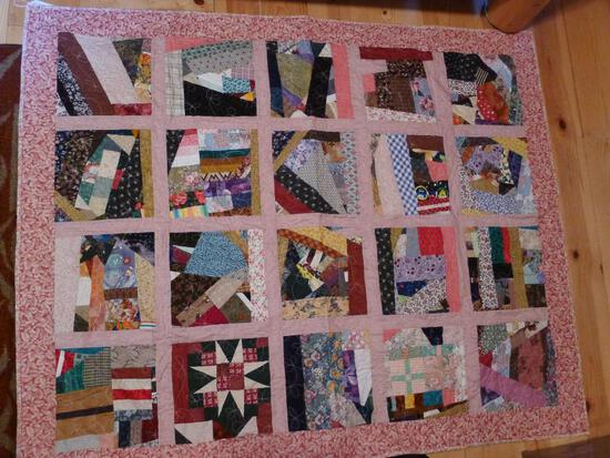 Pretty quilted throw quilt measures 4-1/2' x 3-3/4'.