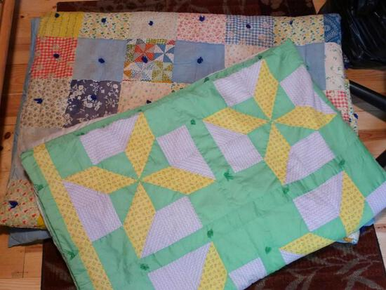 """Two handmade tied quilts. Green/yellow one is 76"""" x 104"""". Blue one is 67"""" x 90"""" has some stains and"""