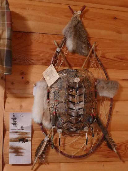 Unique wall hanging with 2 wooden arrows, rabbit fur, turtle shell, antler slices and more. Measures