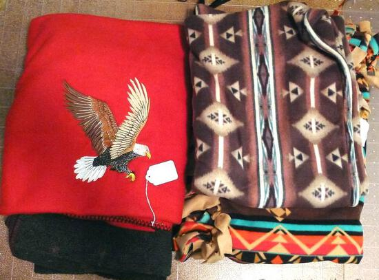 Four Southwest or Native American style blankets/throws. Largest is around 7'.