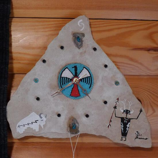 "Native American clock made from a piece of shale or limestone, 14"". May need a battery."