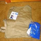 Kool Max personal cooling vest with original paper and cooling packs. Appears unused. Size L/XL.