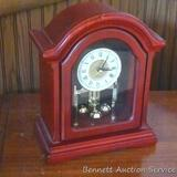 Sweet little mantle clock. We think it has chimes, but couldn't test because batteries need