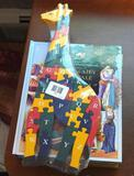 Two Fairy Tale puzzle books; alphabet giraffe puzzle is 16