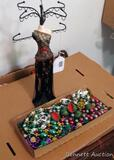 Decorative jewelry stand will hold several necklaces or the like, 15