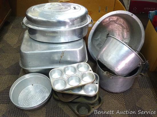 """Roasters, strainer, muffin tins, pots, more. Box is 21"""" long."""