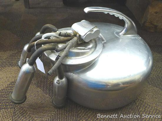 Surge milker bucket with lid, pulsator, and more. See pictures for more. Rubber hoses and inflations
