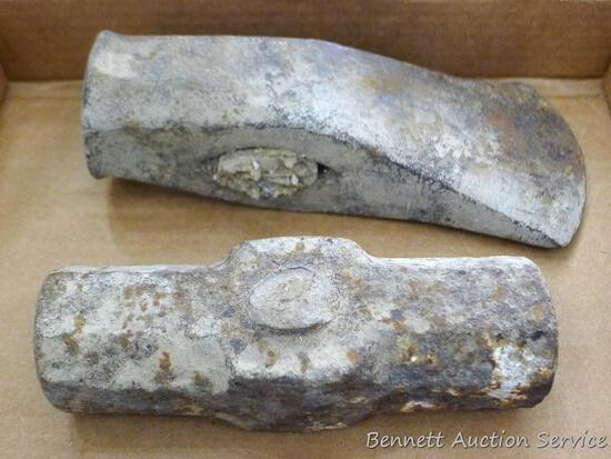 "Splitting maul head and a sledge hammer head. Splitting maul head is 8-1/4"" long; sledge hammer head"