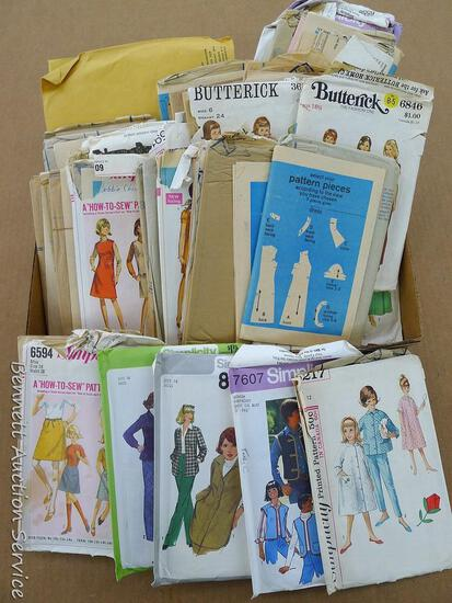 Lots of clothing patterns for women's sizes 16, 16-1/2. 18-1/2, more.  Look to be from 1960s-70s