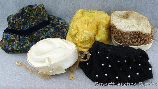 """Several vintage hats up to about 9"""" long."""