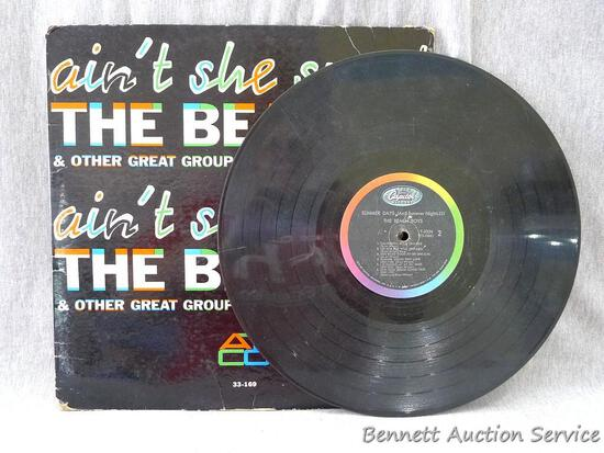 Summer Days (And Summer Nights) record by the Beach Boys in a Ain't She Sweet cover by The Beatles.
