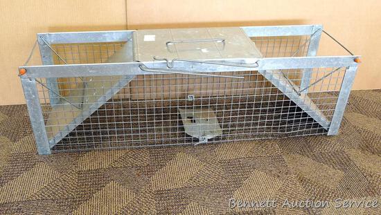 "Large Havahart animal live trap is 11"" x 13"" x 42""."