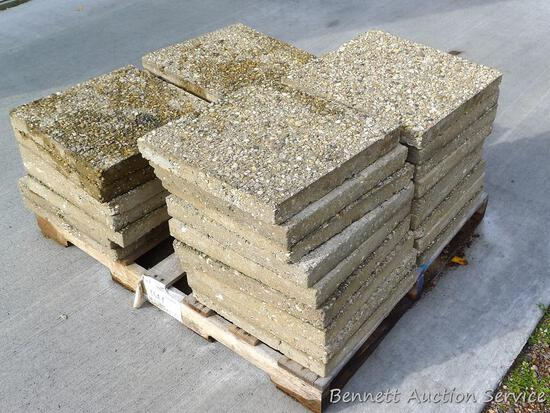 """32 concrete pavers are all about 18"""" x 18""""."""