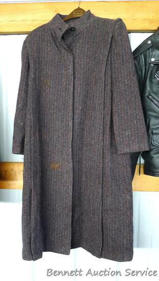 100% wool Projections coat. Spotting noted on bottom of lining, medium sized spot noted on front,