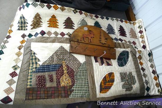 """Pretty Northwoods themed lap quilt and a moose wall hanging. Quilt is 49"""" x 58"""". Some light spots"""