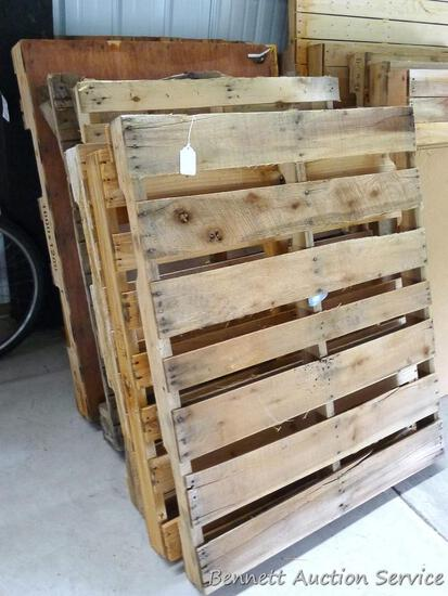 """Stack of 8 wood pallets. Largest is 39"""" x 49-1/2"""". All in good condition."""