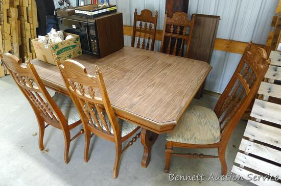 """Nice dining table is 41"""" x 65"""". There are two 11-1/2"""" leaves and 5 chairs with padded seats."""