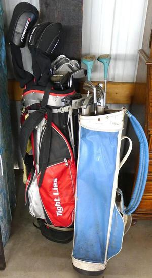 Tight Lies golf bag and clubs, other bag has North Western clubs. Includes lots of sizes, see pics.