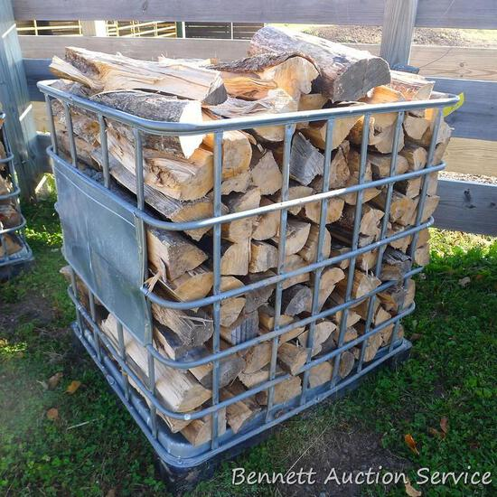 "Metal crate filled with mixed firewood. Crate measures approx. 40"" x 46"" x 45""."