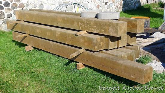 """Ten treated 8"""" x 8"""" posts up to 12' long, plus a 5"""" dia post with gate hardware."""