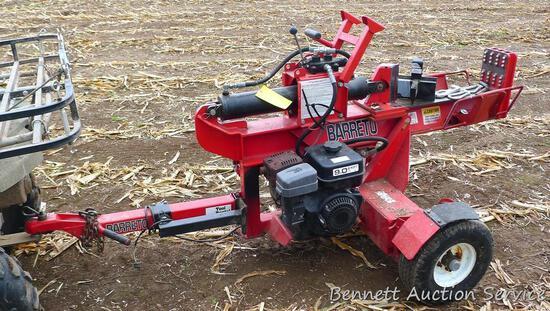 "Barreto hydraulic log splitter has a 24"" capacity. Pivots for vertical usage. Runs. Has a 9.0 motor,"