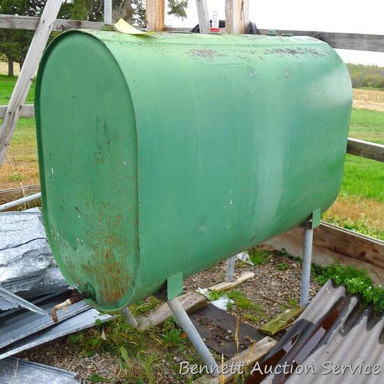265 gallon fuel oil barrel had been inside until the shed fell down. Front legs are bent, but easily