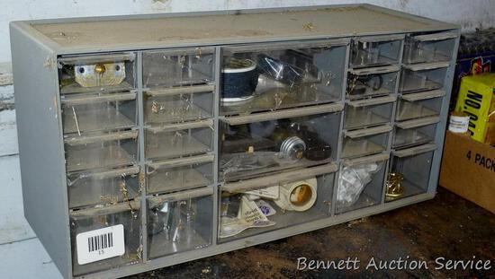 """Organizer cabinet is 6-1/2"""" x 18"""" x 9"""" with contents of fishing line, light sockets, electrical"""
