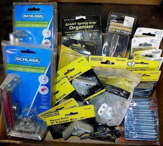 "Misc. items all NIP. Two Schlage 90 degree hasps; 2"" corner braces; ground rod clamp; J-hooks;"