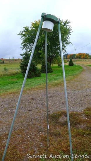 "Aluminum tripod for hanging a deer feeder, has 90"" legs."