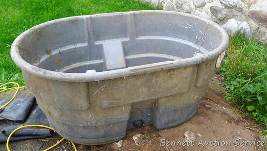 "Rubbermaid Agricultural Products stock tank is about 52"" x 38"" x 24"" high. Bottom is marked ""4245""."